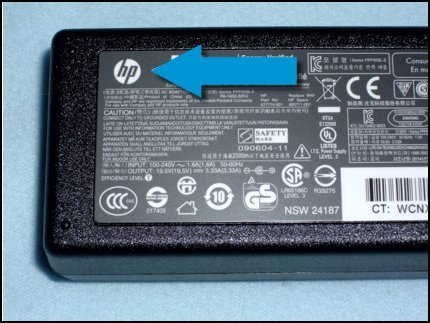 HP logo on the power adapter indicating it is a genuine HP part