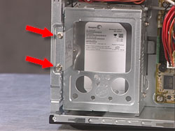 Two screw securing the hard drive cage to the computer