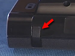 The leg insert in place on the computer