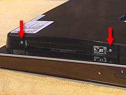 Image showing location of two screws for the optical disk drive