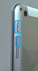 Side view of tablet with the power and volume up buttons highlighted