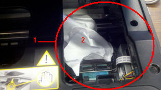 Photo: Jammed paper on top of the printhead in the service station area