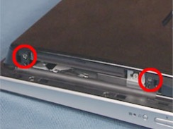Two screws by the optical drive