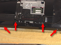 Image showing location of four screws at the bottom of the back cover