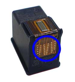 Image of the copper-colored electrival contacts on the cartridge