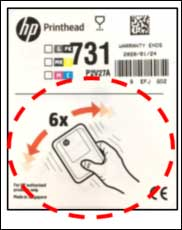 Printhead label with shake instruction