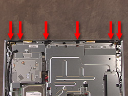 Image of the PC with arrows point to the tabs inside the unit