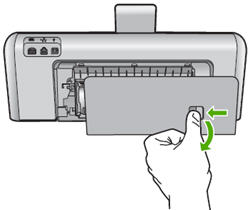 Press in the tab on the rear door and pull it away from the product.