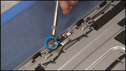 Removing the pink torx head screw