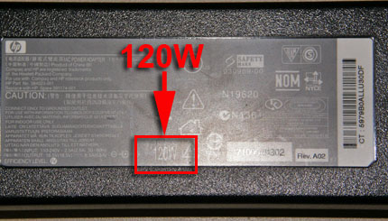 Image of a 120 watt power adapter showing the location of wattage information.