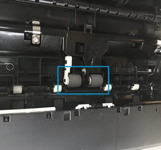 Rodillos debajo de la impresora