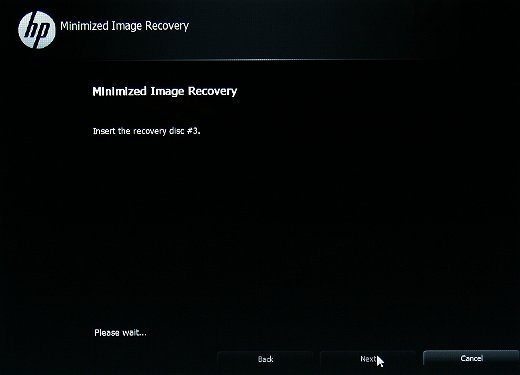 Insertion du disque de restauration suivant