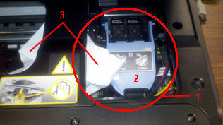 Photo: Jammed paper on the left side of the service station area