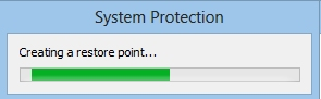 The System Protection window, displaying a restore point creation progress bar
