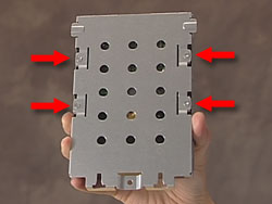 The hard drive cage showing the four screws