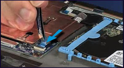 Inserting the hard disk drive ribbon cable into its connector