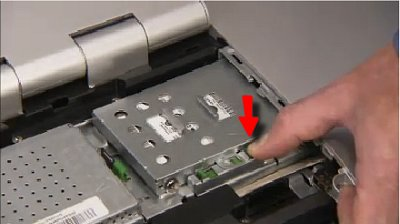 Removing the screw that secures the hard drive