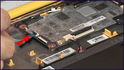 Inserting the touchpad ribbon cable into its connector