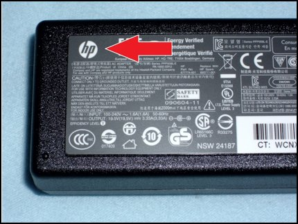 AC power adapter with HP logo highlighted