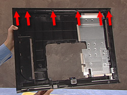 Image showing back cover with arrows point to hooks on top edge