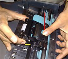 Holding the ADF rollers and pressing the ADF blue-green release button located at the top, center of the pick assembly.