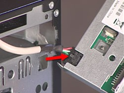 Pressing down on the card reader cable latch